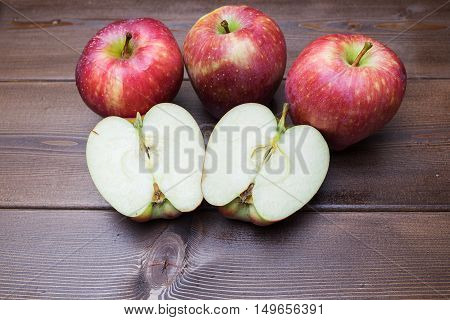 Red Fresh Apples On The Wooden Table