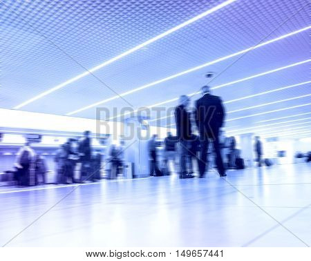 abstract blur of passengers staying at big city station.