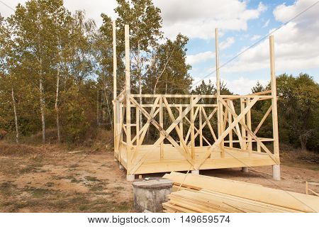 Construction of ecological house. Wooden frame of house under construction.Framed New Construction of a House. Timber house in building process