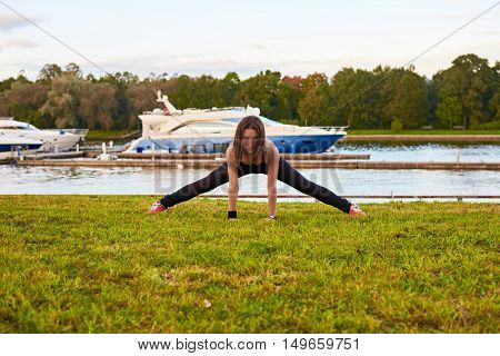 Morning happiness in the park. Sport exercises with stretcj