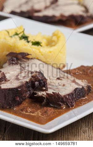 portion of veal with polenta on a plate
