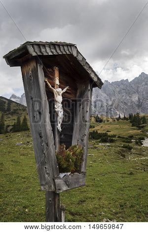 cross in the karwendel alps in fall