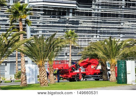 Sochi, Russia - Noveamber 12, 2014: Especial machinery maintenance in the Olympic park of Sochi, building of autodrom for Formula-1 on the background