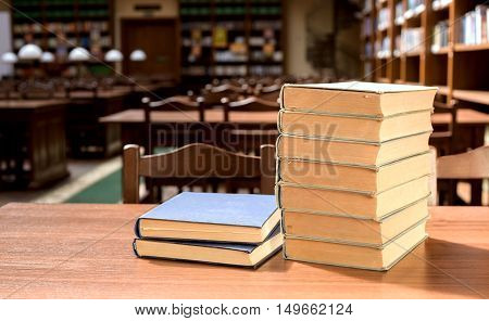 piles of books in library hall (Shallow depth of field)