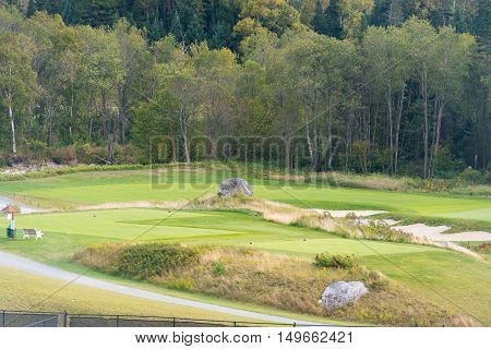 Beautiful golf course surrounded by mountains in New England