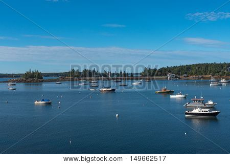 Seal Harbor Maine US -- Sept 22 2016. Small boats are anchored in deep blue harbor waters on a crisp Autumn morning. Editorial Use Only.