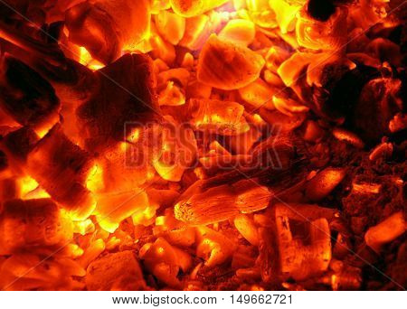 The embers of wood burning on the fire