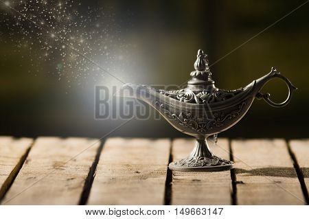 Beautiful antique metal lamp in true Aladin style, animated star dust coming out, sitting on wooden surface.