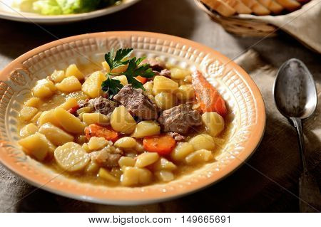 beef stew, potatoes and greens on the original napkin, spoon vintage