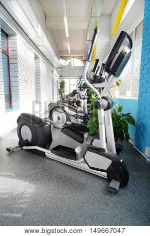 Interior of a modern fitness hall with fitness machines