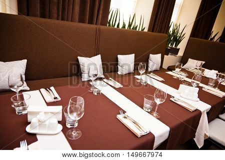 interior of the restaurant a table with instruments comfortable armchairs