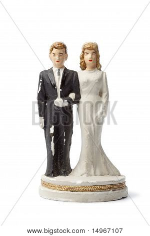 Old damaged plaster bride and groom