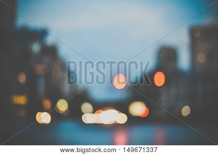 Blurred evening city lights out of focus bokeh background