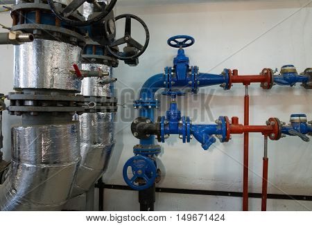 Place in a large industrial boiler room. Parts replaced during repair work
