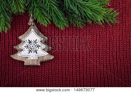 Christmas red knitted background with christmas tree decoration in country farmhouse style