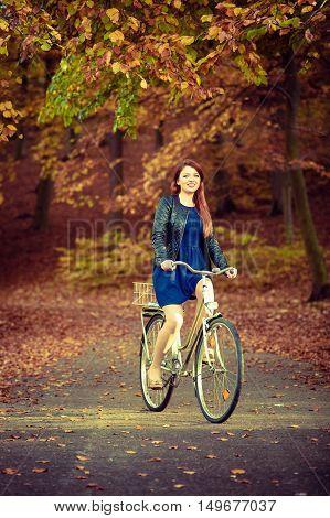 Girl In Dress On Bike.