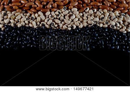 Varied diferent beans,mixed in the studio table,  with negative space bottom.