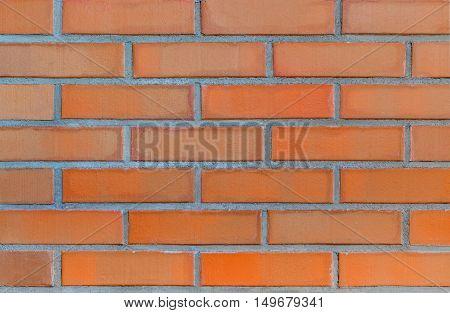 Part of modern red clay brick masonry. Brick wall texture background.
