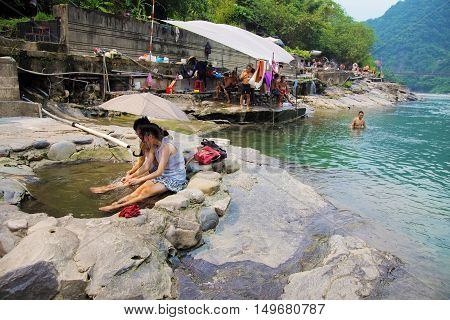 TAIPEI TAIWAN - AUGUST 27: Taiwanese people enjoying the hot springs in the famous hot spring village of Wulai on August 27th 2014 in Taiwan