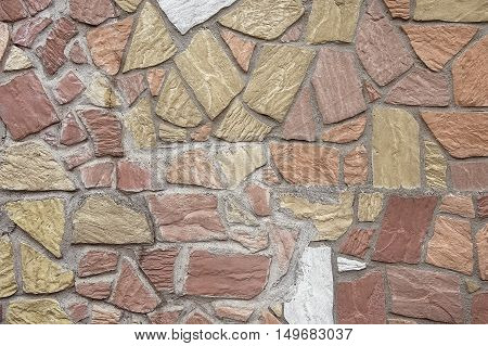 Old colorful stone wall background texture close up