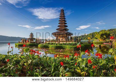 Pura Ulun Danu Bratan Bali. Hindu temple surrounded by flowers on Bratan lake Bali. Major Shivaite water temple in Bali Indonesia. Water temple in Bali Indonesia. Hindu temple of Bali Indonesia