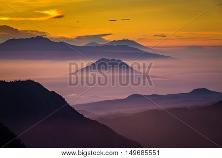 Layer of mountains and mist at sunset time Landscape at Tengger Semeru National Park East Java Indonesia