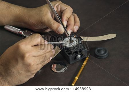 watchmaker will repair watch with his tools - can use to display or montage on product