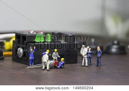 manufacture scene of mini worker and mini boss at led factory - can use to display or montage on product