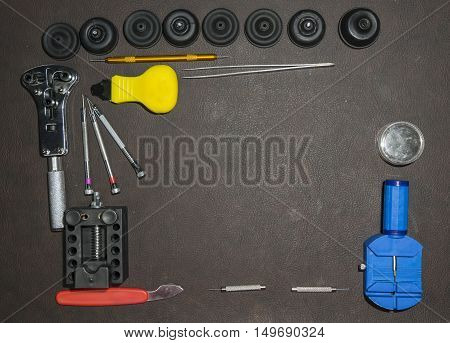 set of watchmaker tools on ltable - can use to display or montage on products