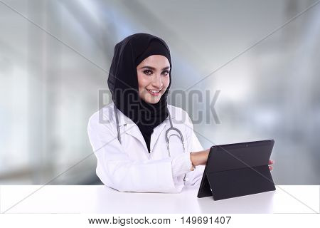 Muslimah Doctor Isolated On Blur Background
