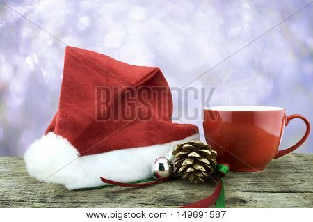 Santa Hat,red Cup Hot Drink ,pinecone And Christmas Decorate Staff On Woodden Table