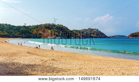 Tourists on Nai Harn beach on a sunny day, Phuket, Thailand