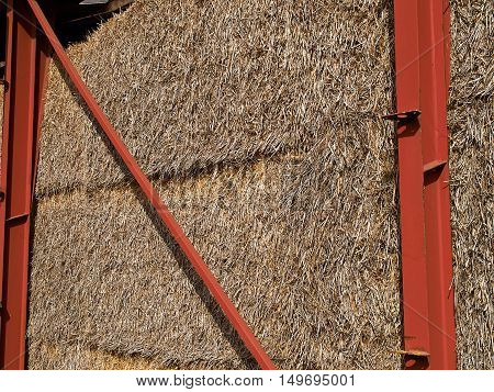 Bales of hay stored in a big agriculture farm a sign of harvest time