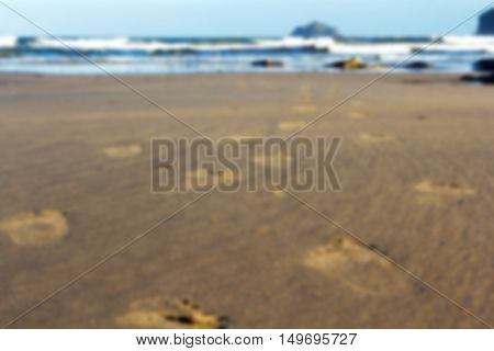 Footprints In The Sand On Polzeath Beach Out Of Focus.