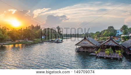 Tourists restaurants on the floating house rafting at the river Kwai, Kanchanaburi, Thailand