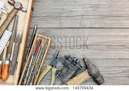 Set Of Old Instruments For House Repair And Construction In Small Toolbox On Wooden Boards Backgroun
