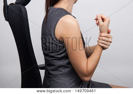 a business woman with a wrist pain