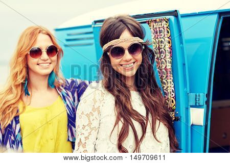 summer holidays, road trip, vacation, travel and people concept - smiling young hippie women over minivan car