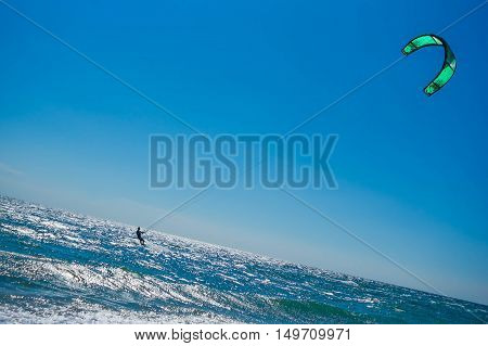 A kite surfer rides the waves sea sun vacation