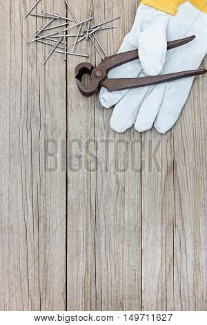 Working Gloves With Nails And Pincers On Grey Wooden Boards