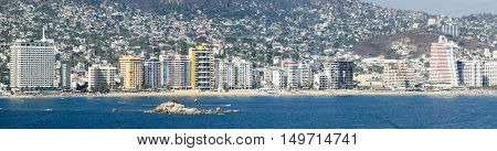 A panoramic view of the skyscraper riviera of Acapulco Mexico.