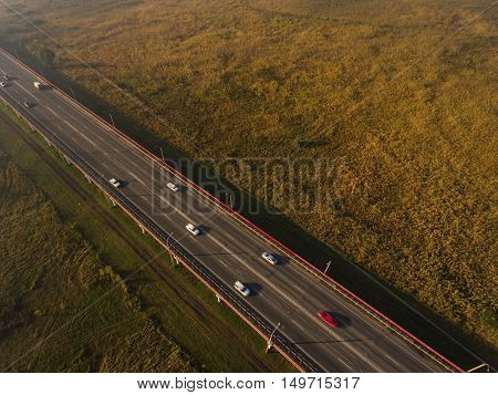 Autumn morning fog over highway. Aerial view.