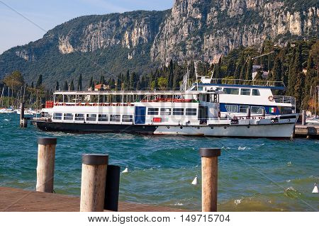 Two ferry boats moored in the port of the small town of Garda in the Garda Lake Verona Veneto Italy