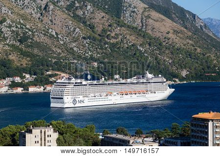 KOTOR MONTENEGRO - 13TH AUGUST 2016: A view towards an MSC Cruise liner in Kotor Bay during the day in the summer.