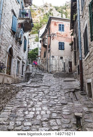 KOTOR MONTENEGRO - 13TH AUGUST 2016: Streets of Old Town Kotor during the day showing the outside of buildings. People can be seen.