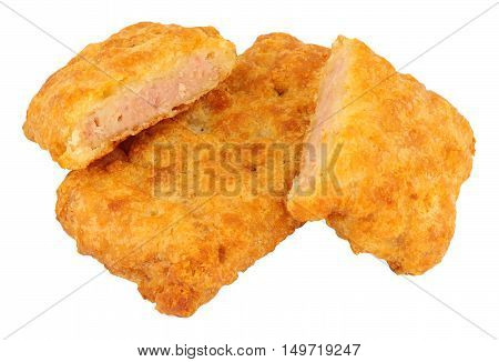 Fried batter covered spam fritters isolated on a white background