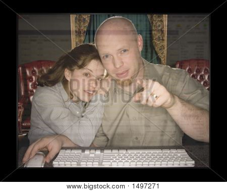Man And Woman Looking At Computer