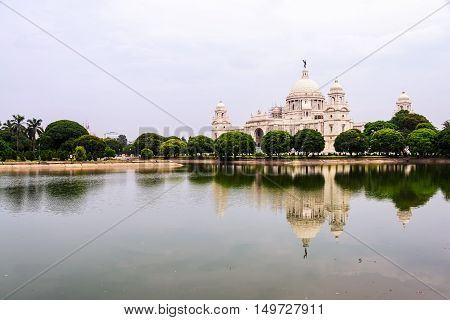 Victoria Memorial Hall in Calcutta, India. With a reflection in a pond. Popular park among locals and a touristic landmark