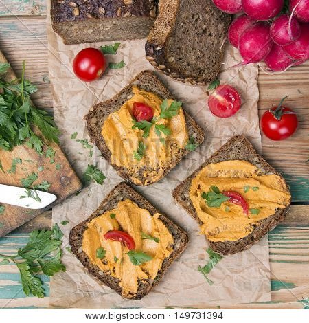 sandwich with tomato pate and chopped parsley - delicious breakfast