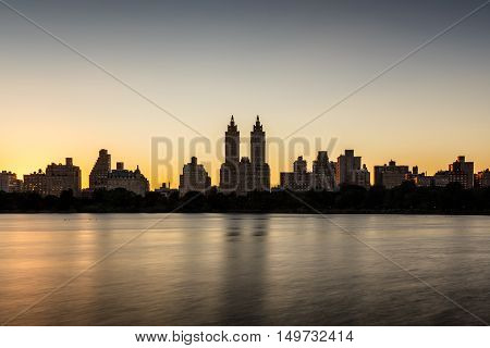 Upper West Side buildings and Central Park Jacqueline Kennedy Onassis Reservoir at sunset. Manhattan, New York City